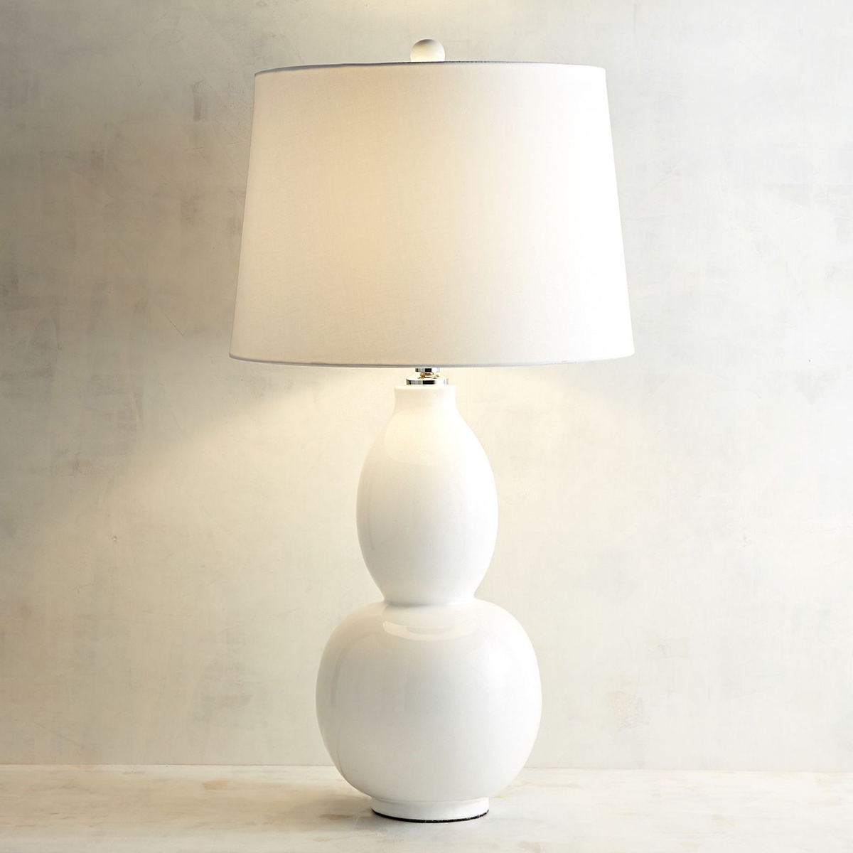 Sleek and modern white table lamp. photo