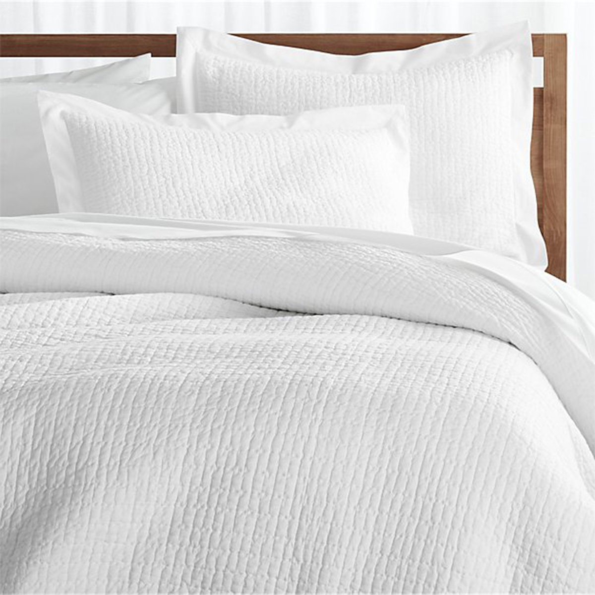 All-white soft cotton bed set and matching pillow shams. photo