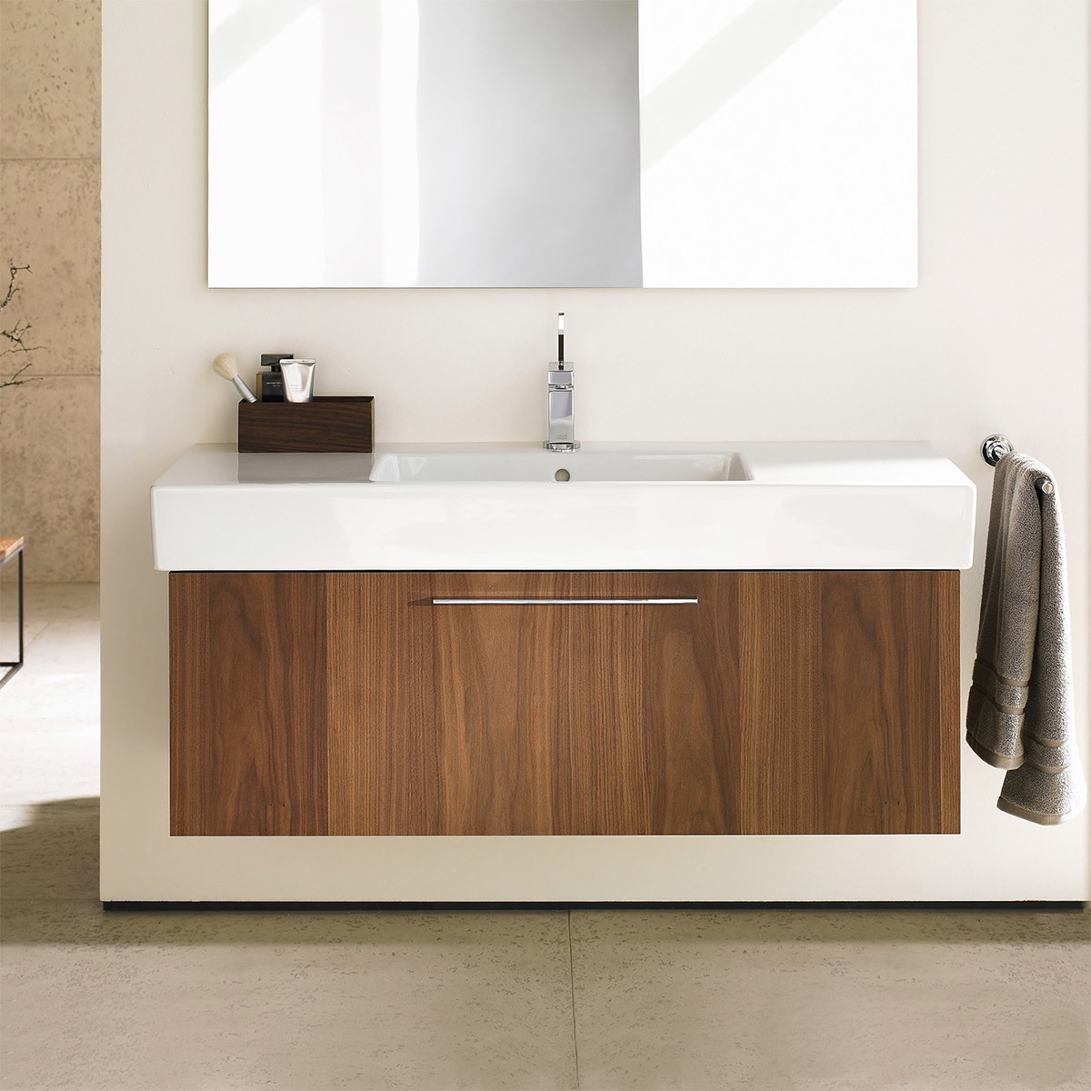 Floating vanity with walnut cabinets and white countertop photo