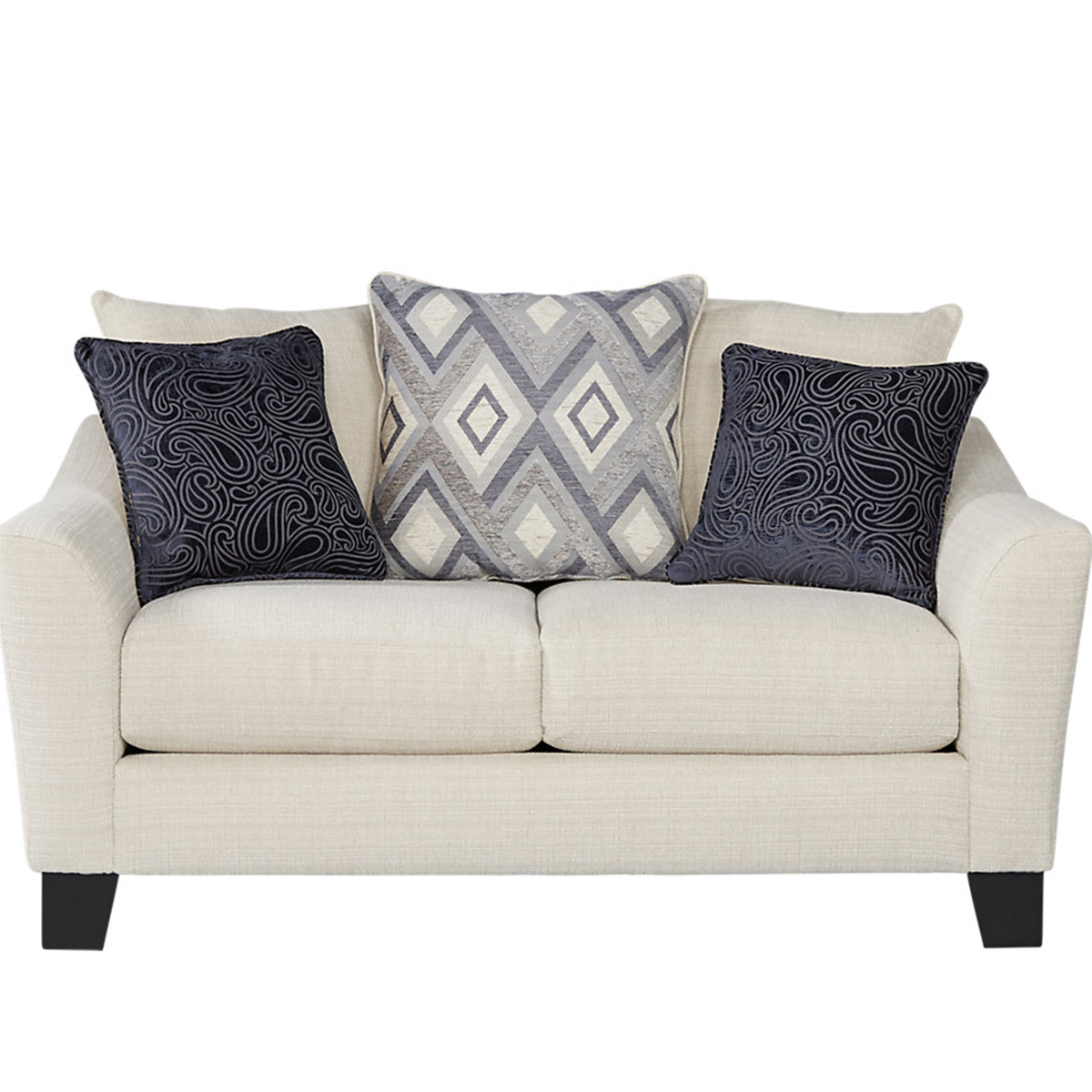 Cream love seat comes with patterned throw pillows photo
