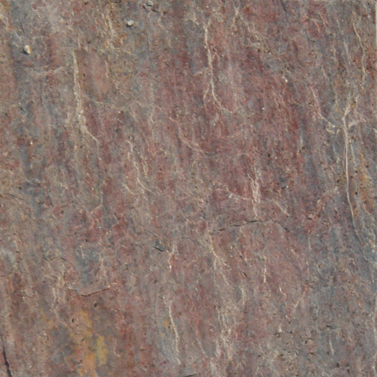 Reddish gray natural stone bathroom tile from Wayfair photo