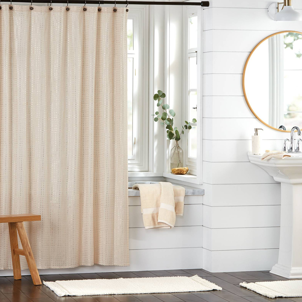 This metallic gold curtain is an easy way to update your bathroom without being overbearing. photo