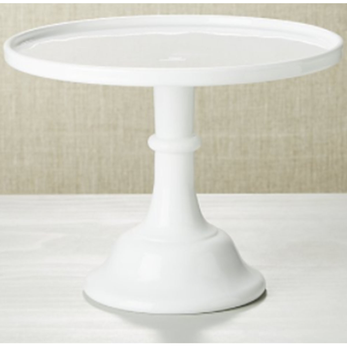 Tall white cake stand with a vintage-inspired look photo