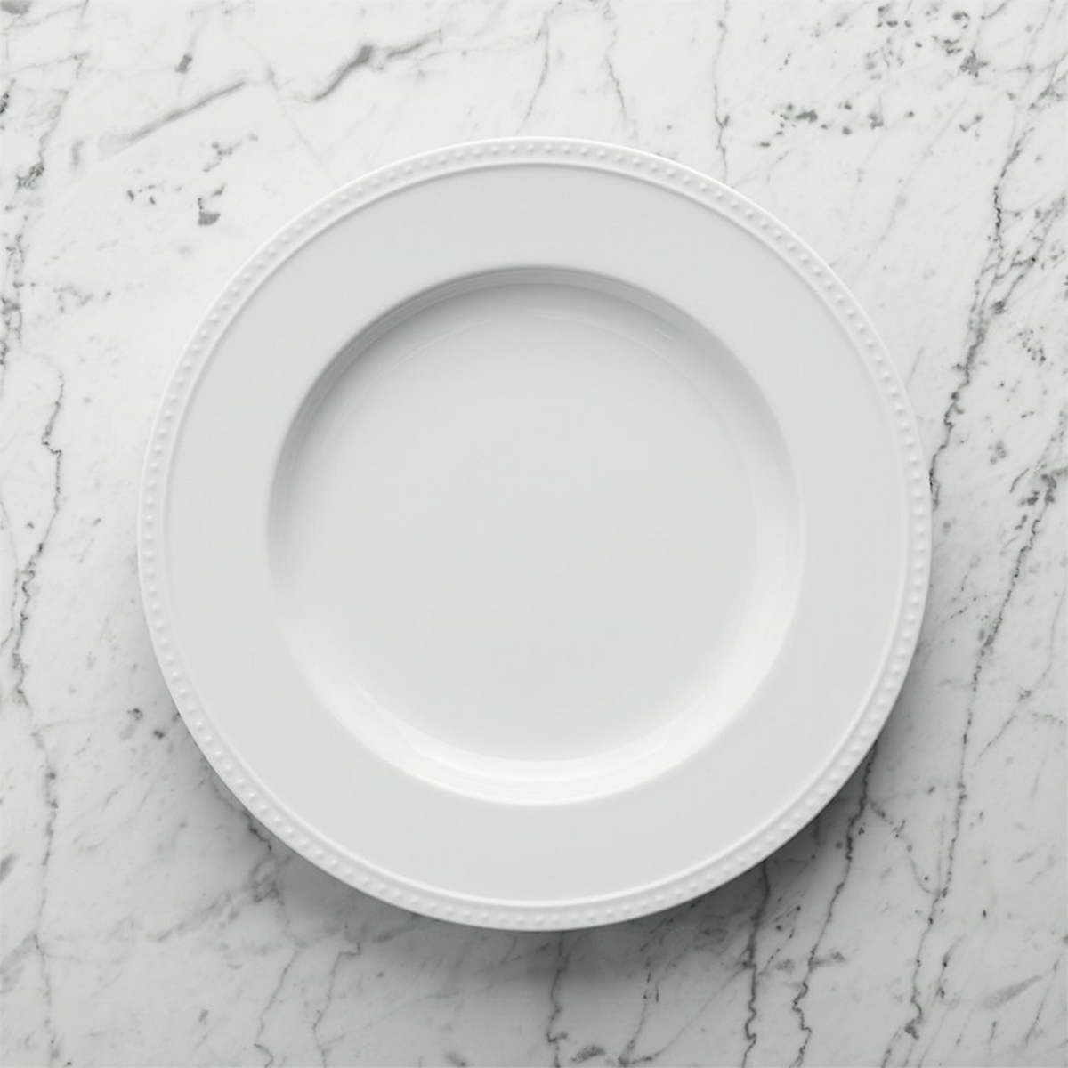 White dinnerware with dot-detailing are suitable for everyday use no matter the season. photo
