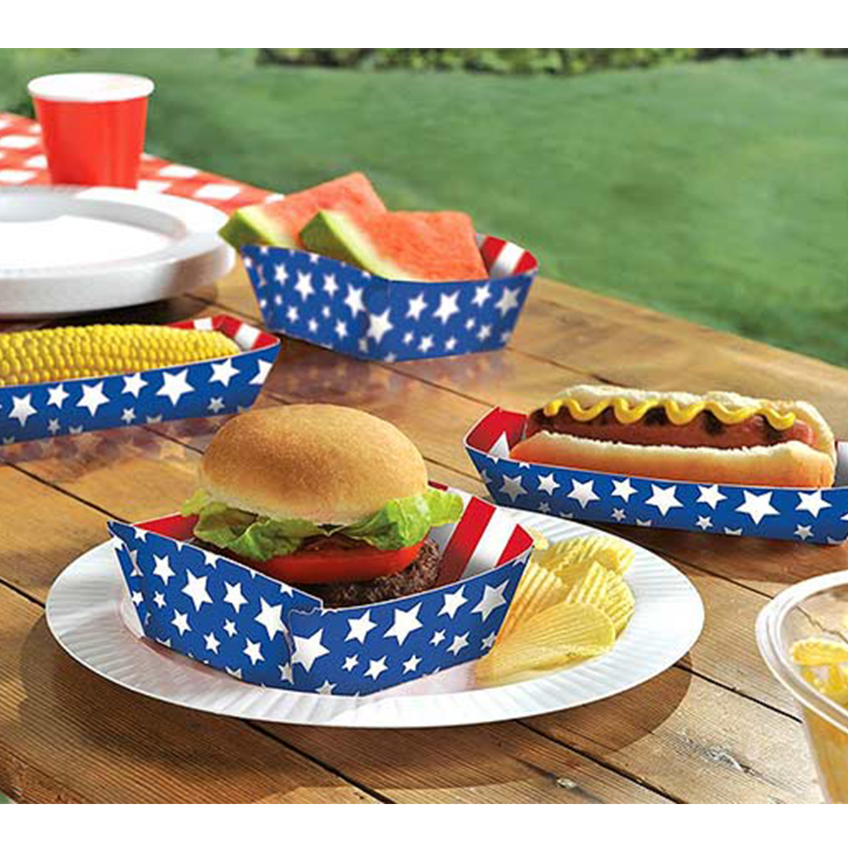 Paper food trays with red and white striped insides and blue and white stars on the outside photo