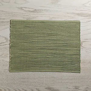 Green woven place mat from Crate and Barrel photo