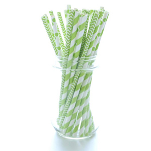Green straws with different patterns like polka dots, stripes, and zig-zags photo