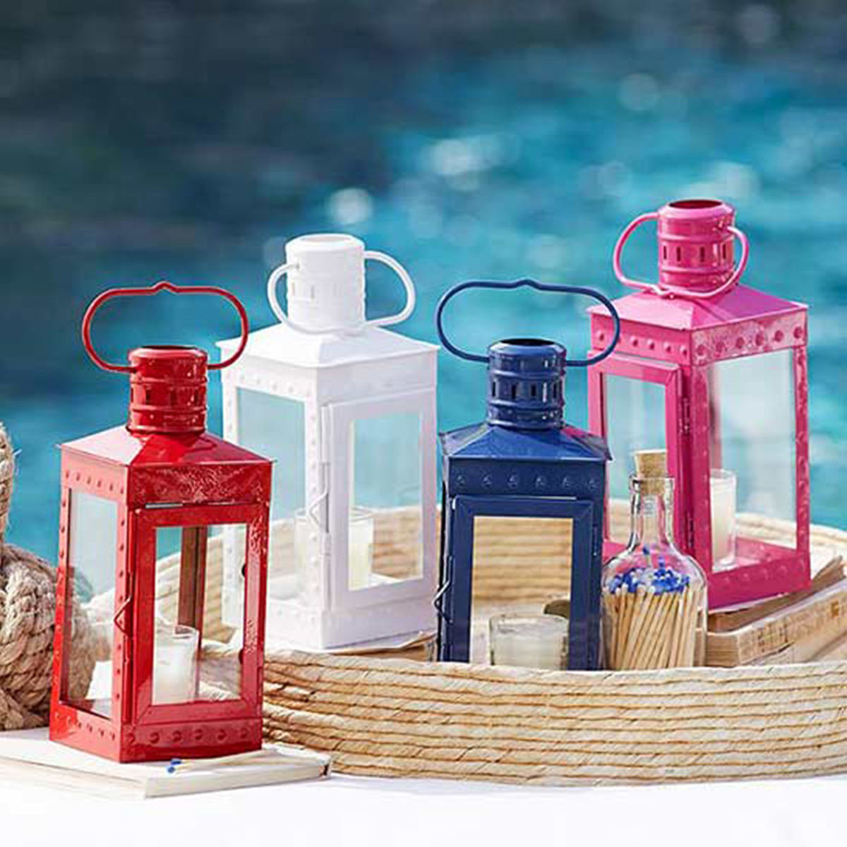 Pottery Barn lanters in bink, blue, red, and white photo