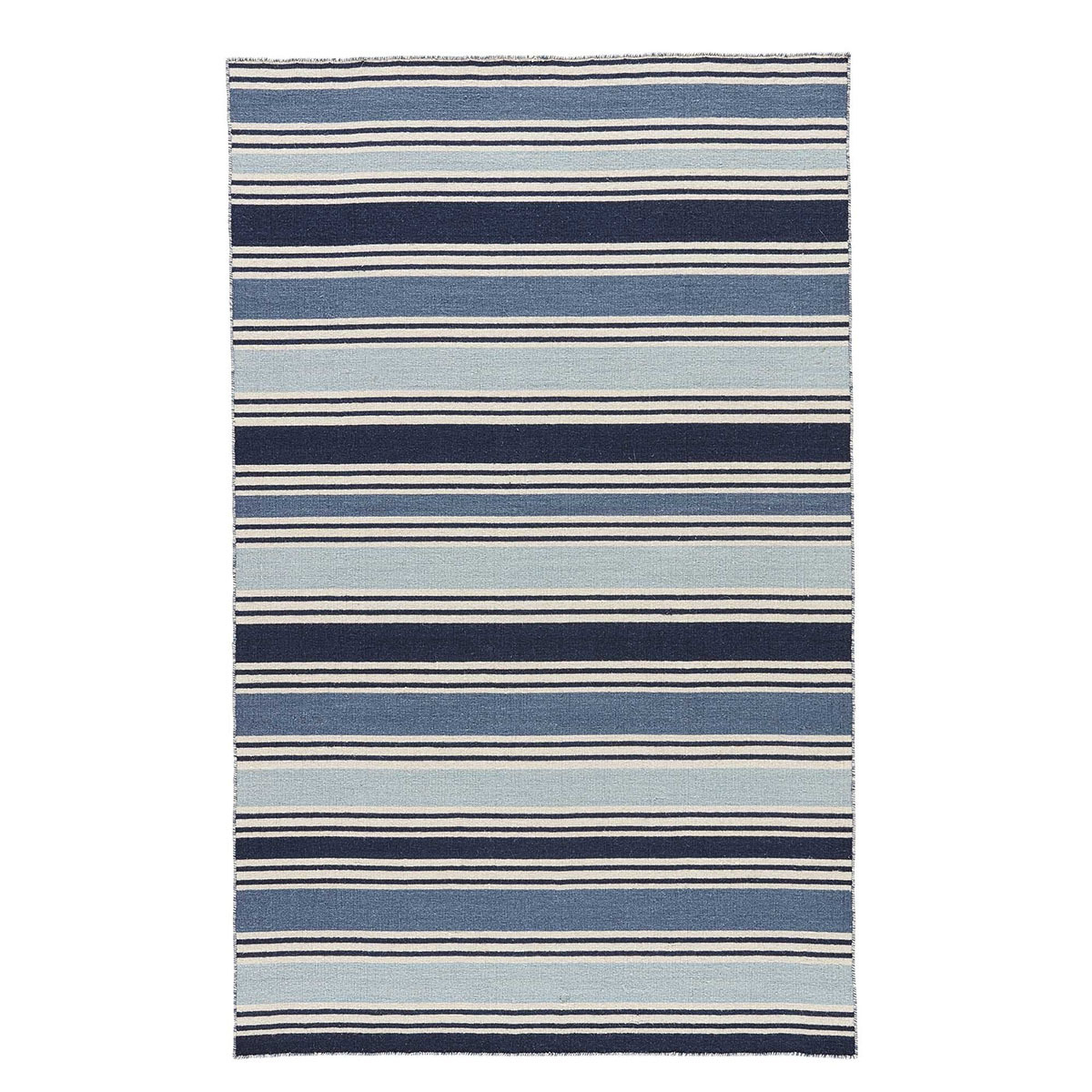 Coastal-inspired wool rug designed with a variety of blue tones. photo