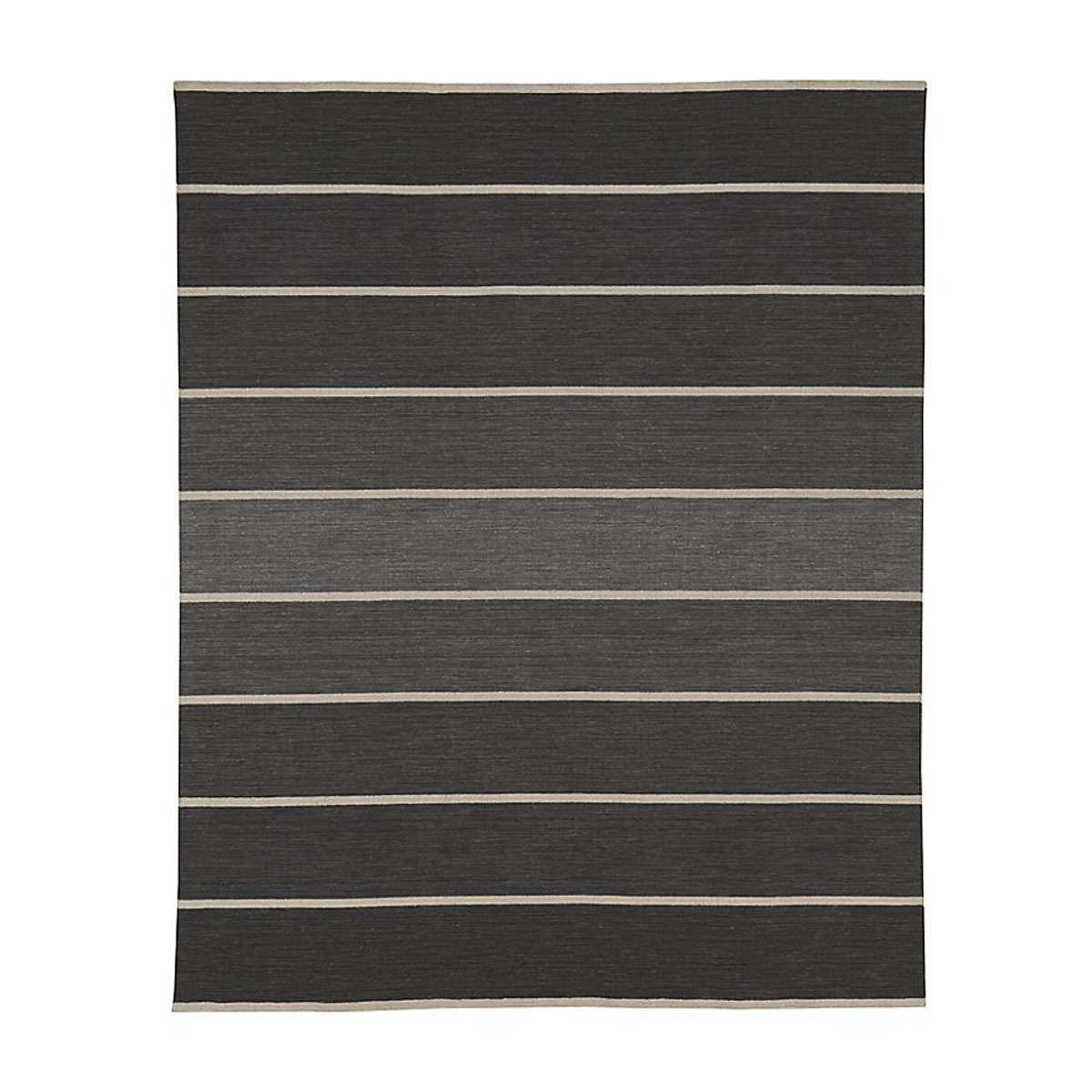 Industrial-inspired rug with an array of grays and straight lines. photo