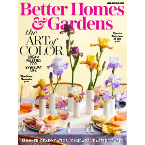 Magazine cover with table setting featuring assorted flowers. photo