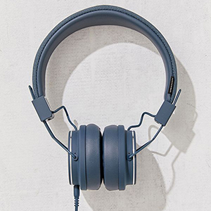 Navy over-ear headphones on grey background. photo