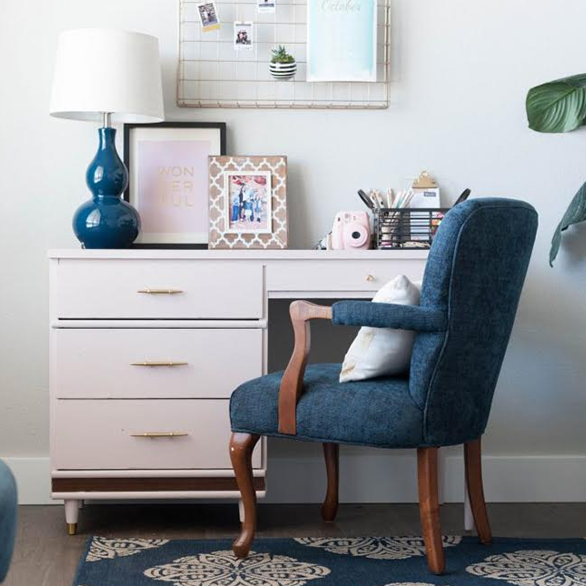 Office space with white desk and blue upholsterd chair photo