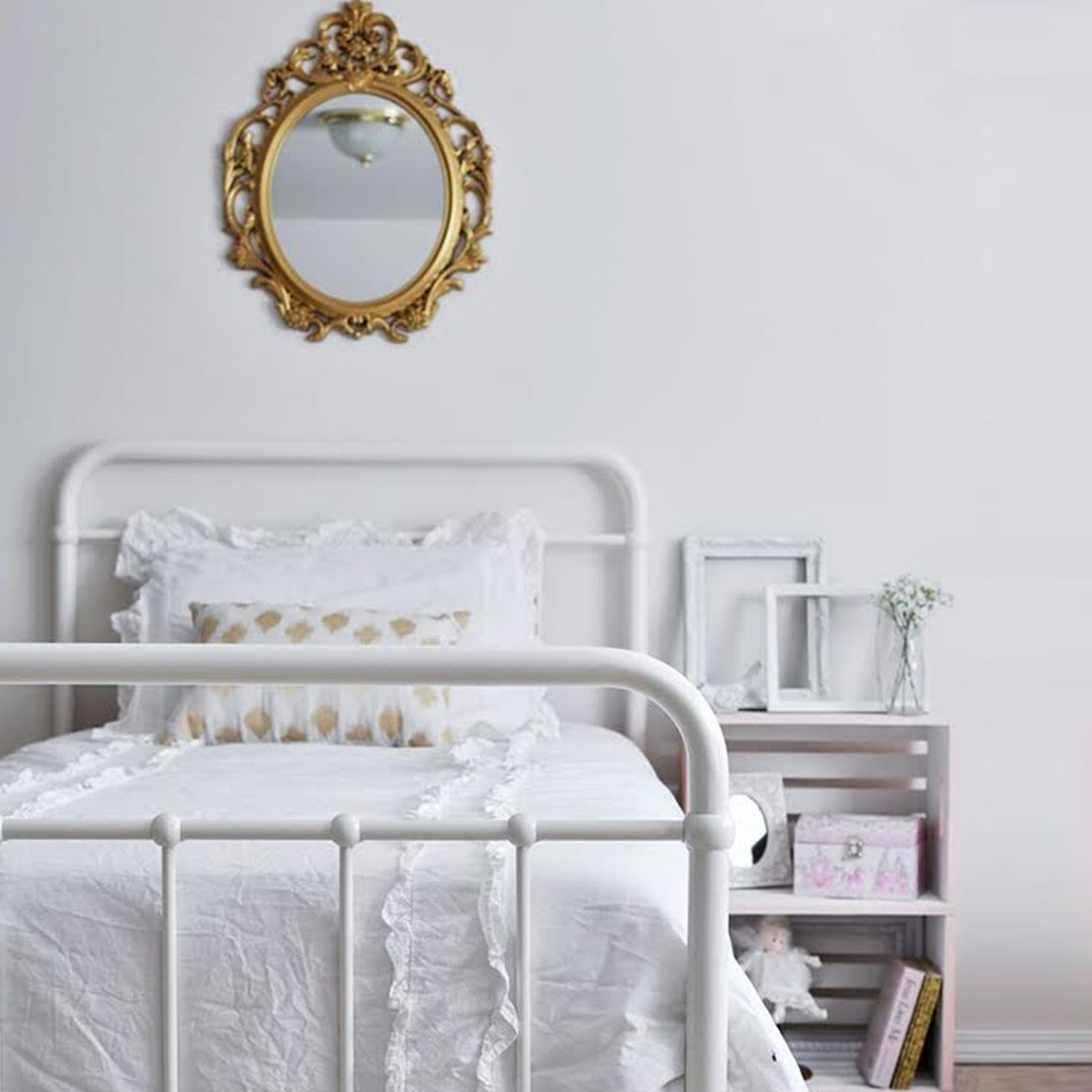 Neutral bedroom with white metal bed frame photo