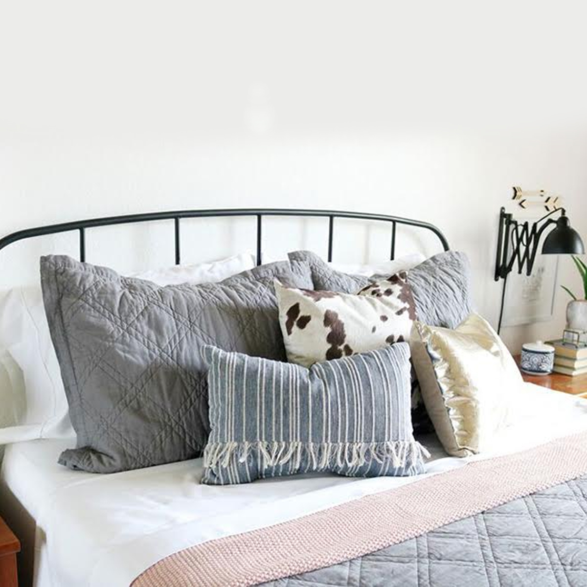 Modern and minmalist bedroom with muted blue and rose tones photo
