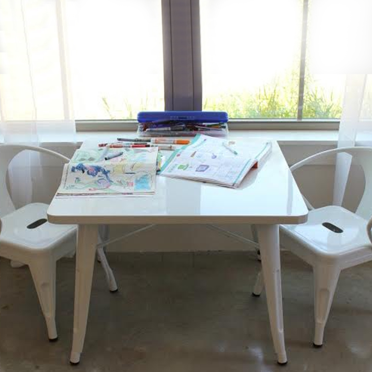 Modern kids play nook with white table and set of two chairs photo