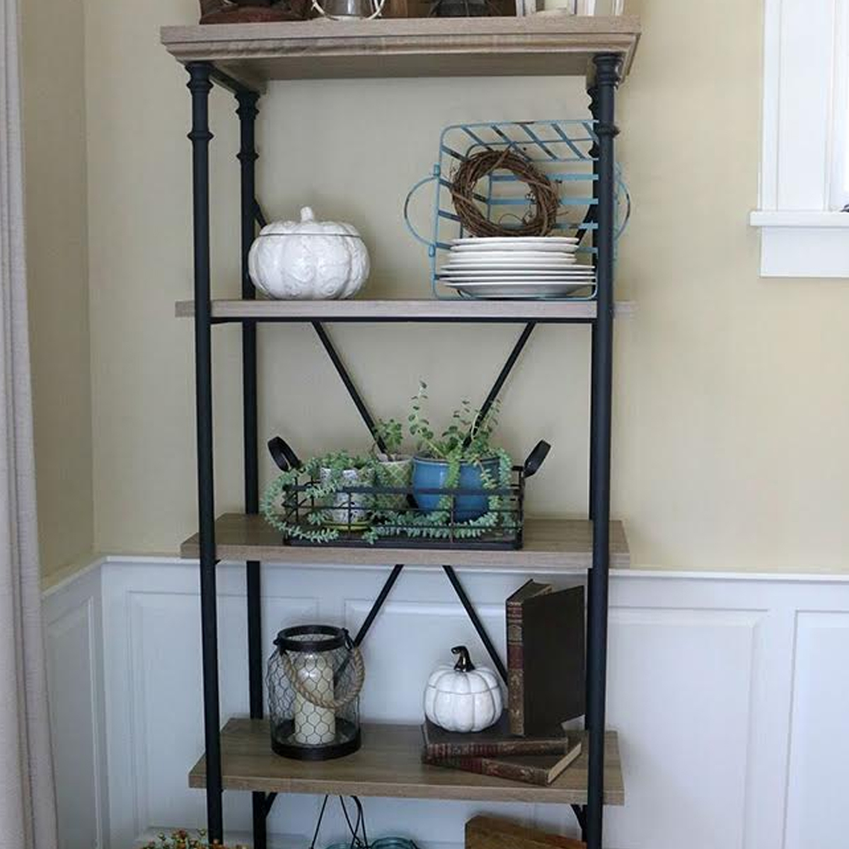 5-shelf bookcase with simple decor items dsiplayed on it photo