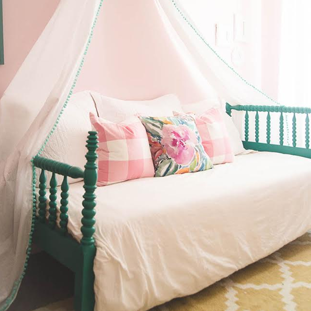 Girly daybed with pink throw pillows photo