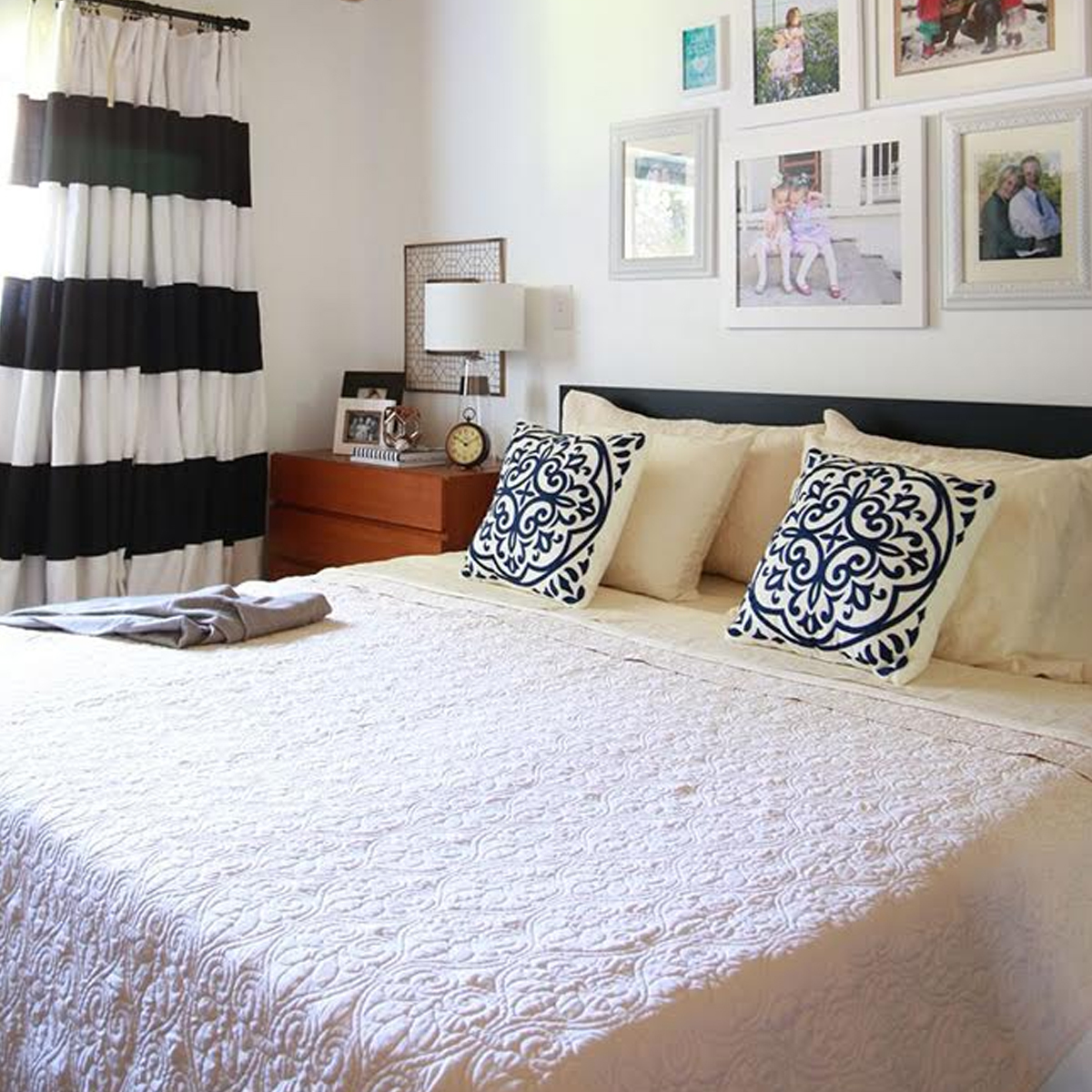 Master bedroom with quilted bedding and gallery wall photo