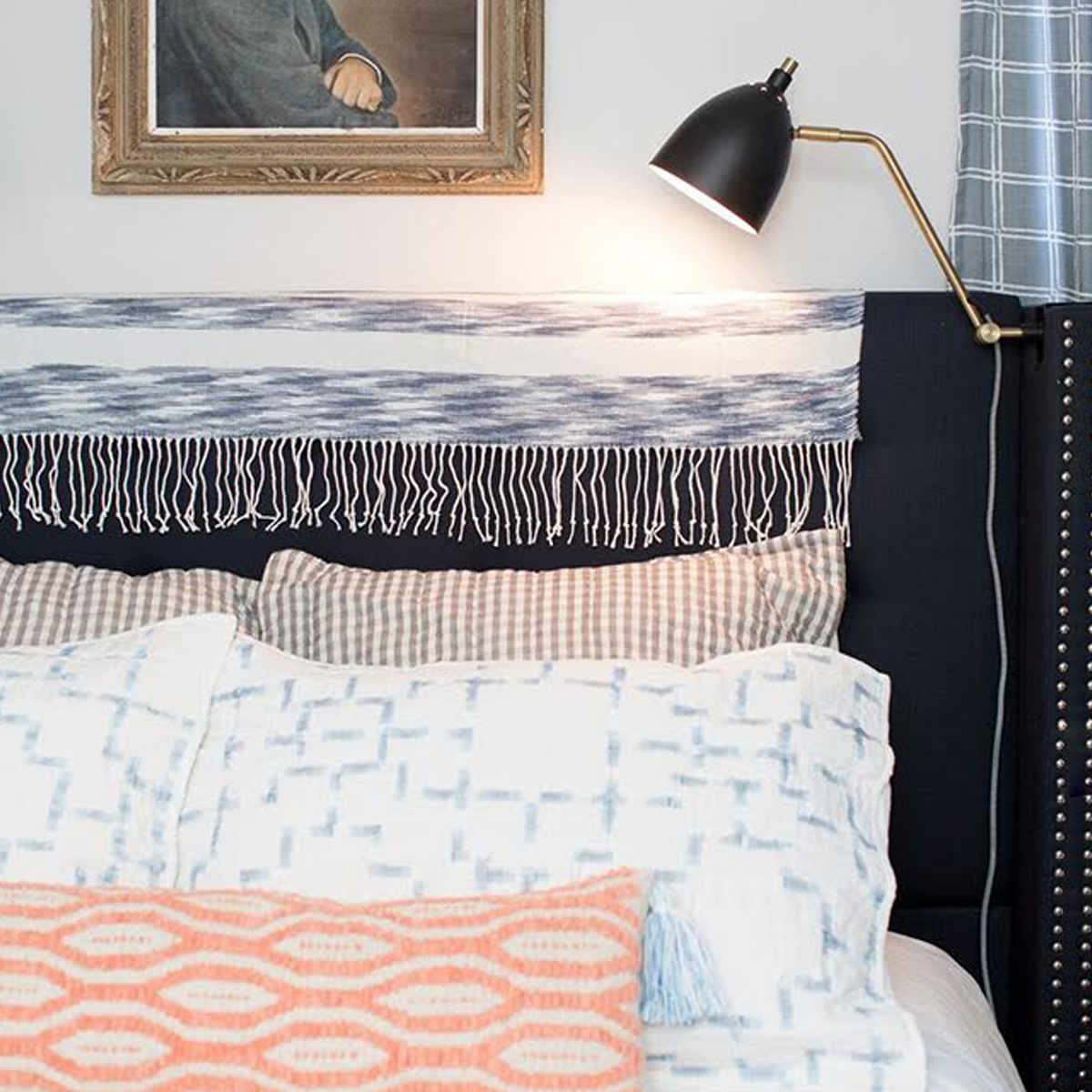 Layered decorative pillows in a multitude of patterns photo