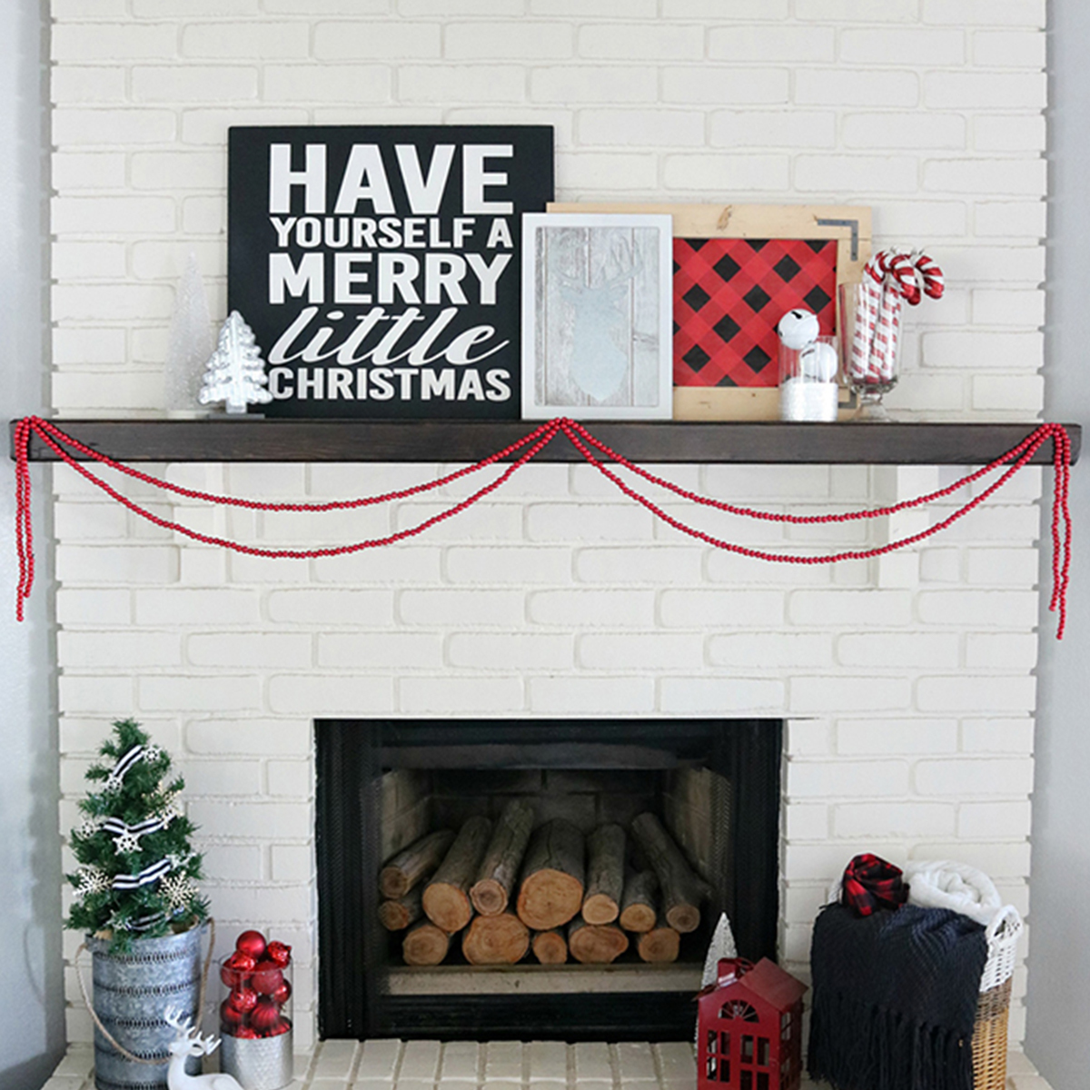 Better Homes & Gardens plush velvet throws and shelf with Christmas decorations on it photo