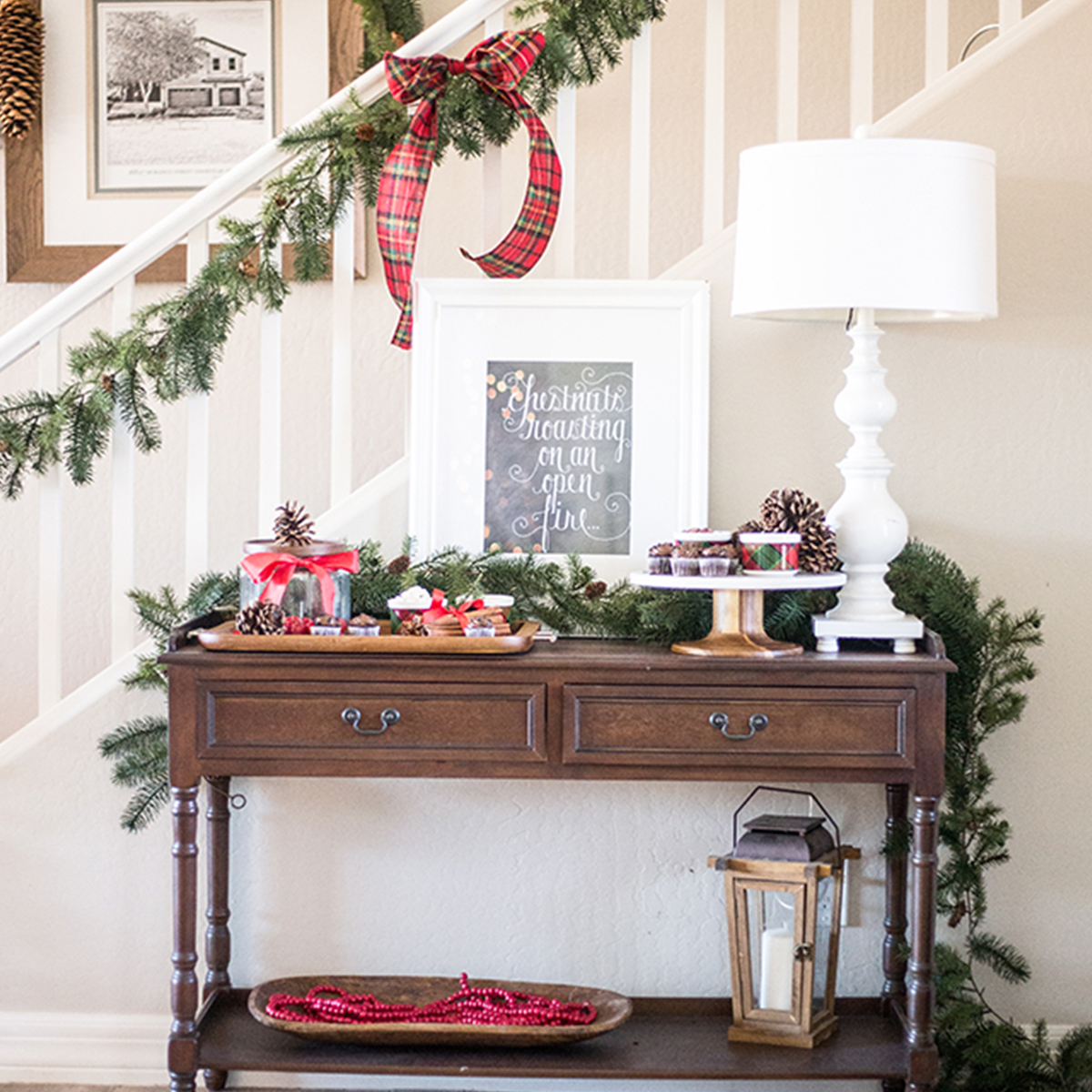 Better Homes & Gardens console table with lamp and christmas decorations photo