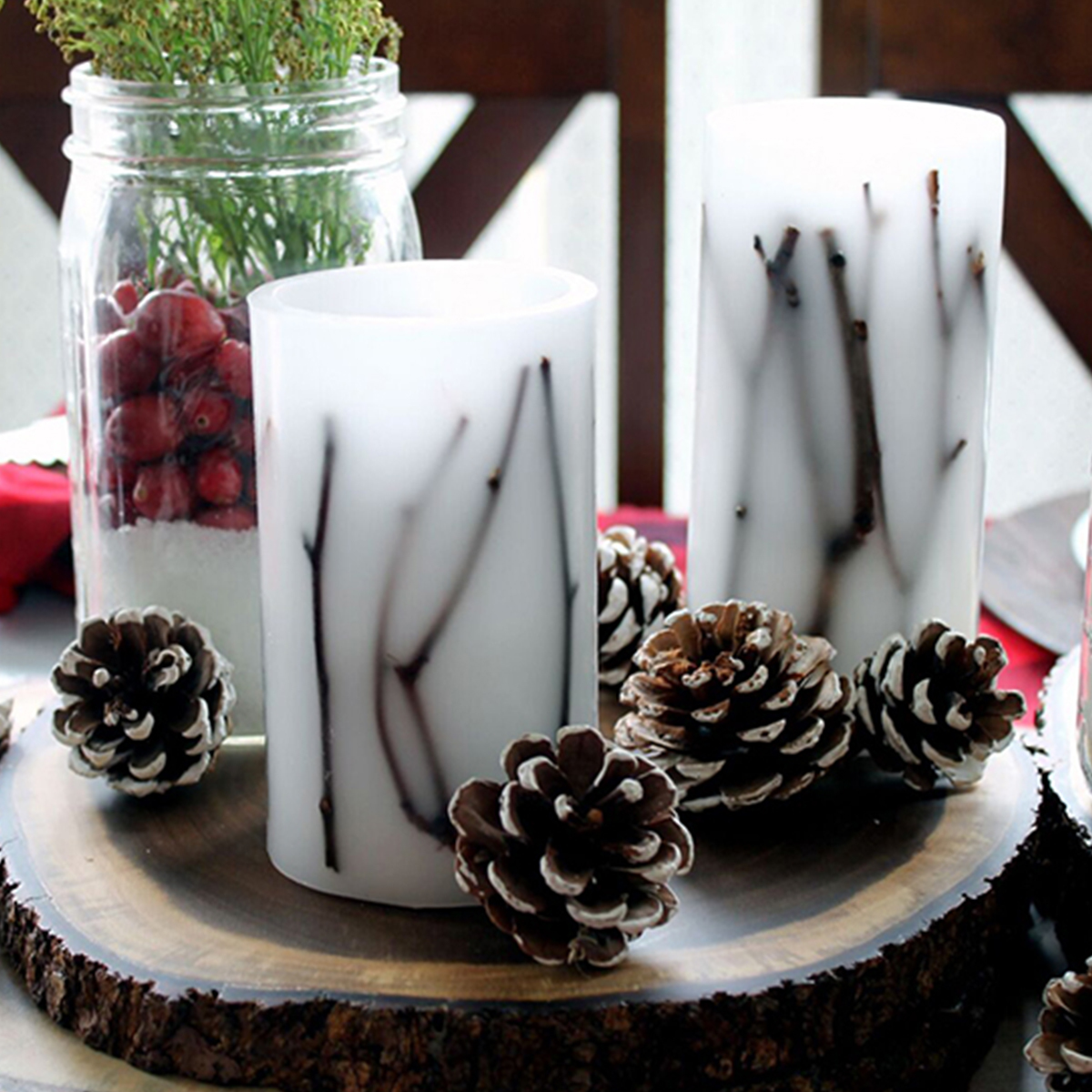 Better Homes & Gardens candles with pinecones and tree branches photo