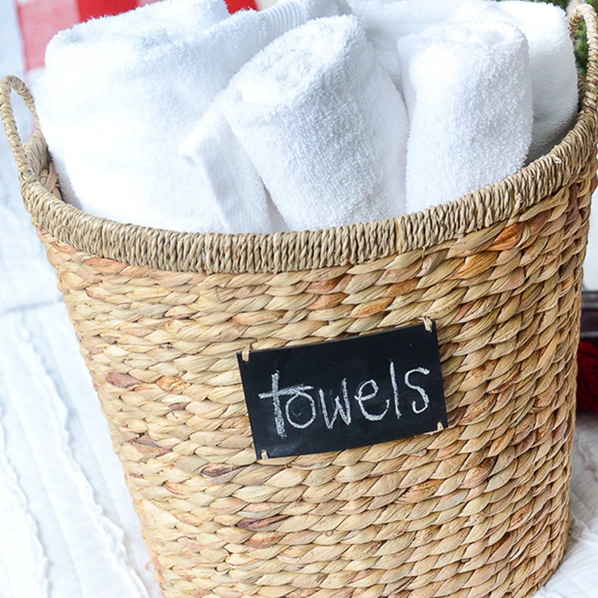 Better Homes & Gardens wicker basket with white bath towels photo
