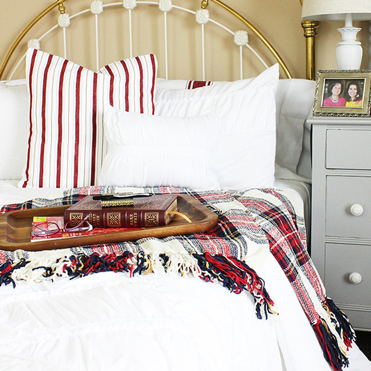 Better Homes & Gardens comforter with red and white plaid blankets and pillows photo