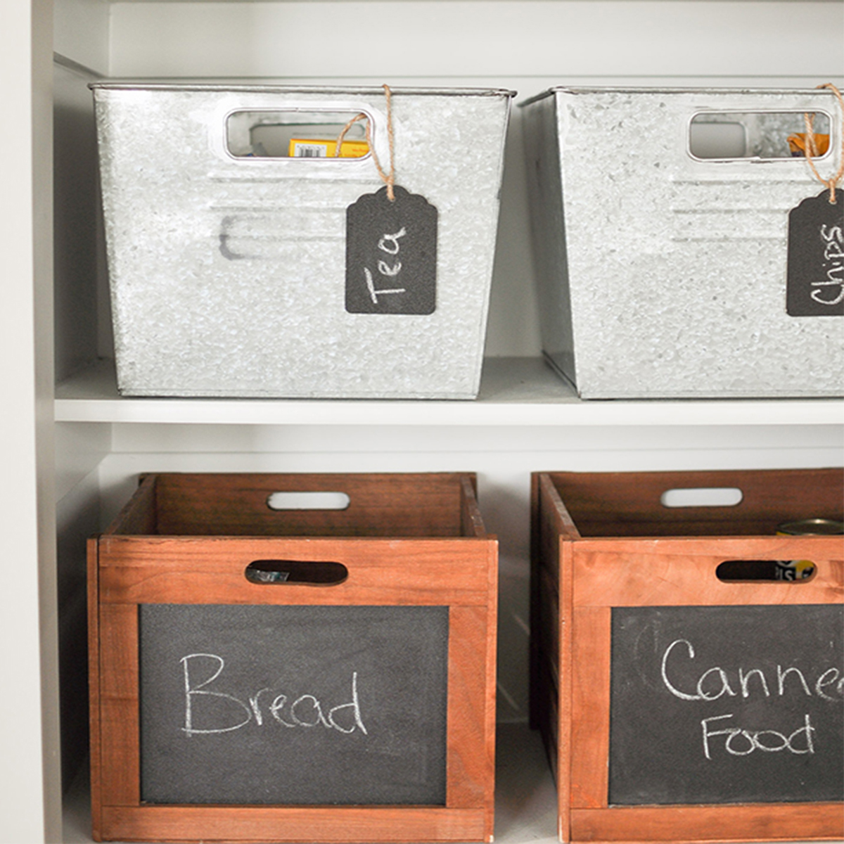Keep your pantry organized with wood décor crates and large galvanized bins. photo