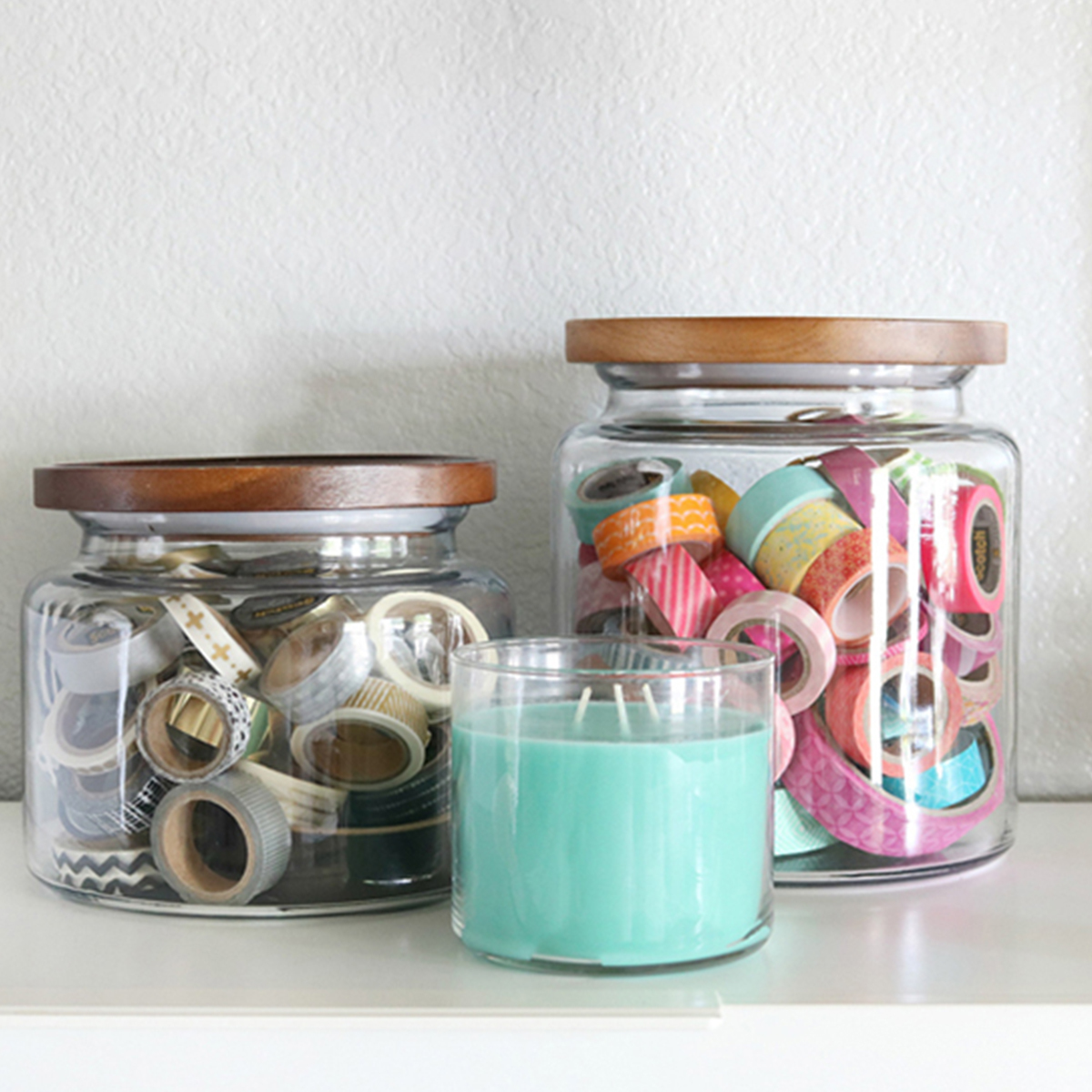 Acacia wood-top jars available in a variety of sizes for added organization. photo