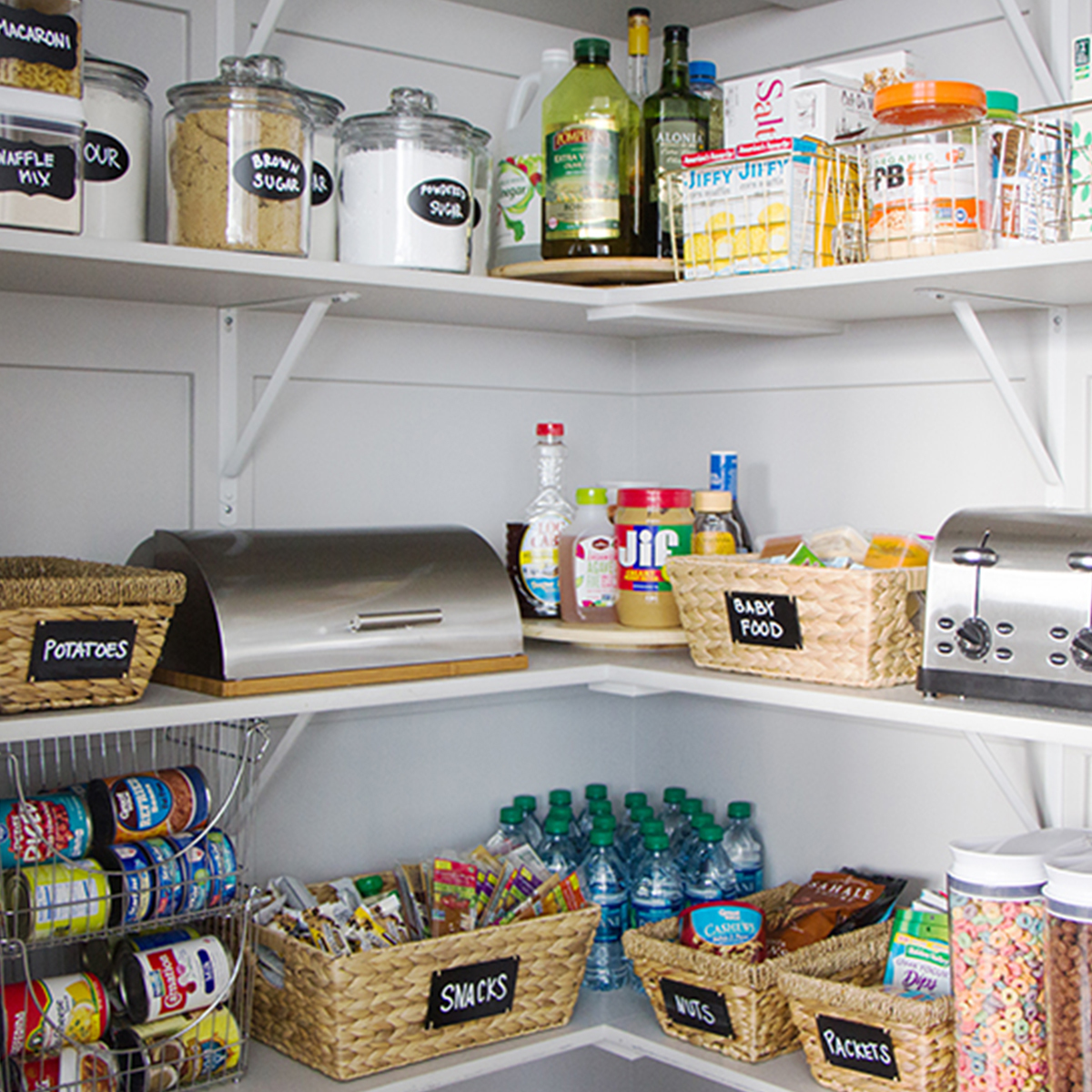 Organize your pantry with twist taper baskets, cereal canisters, and a stainless steel bread box. photo