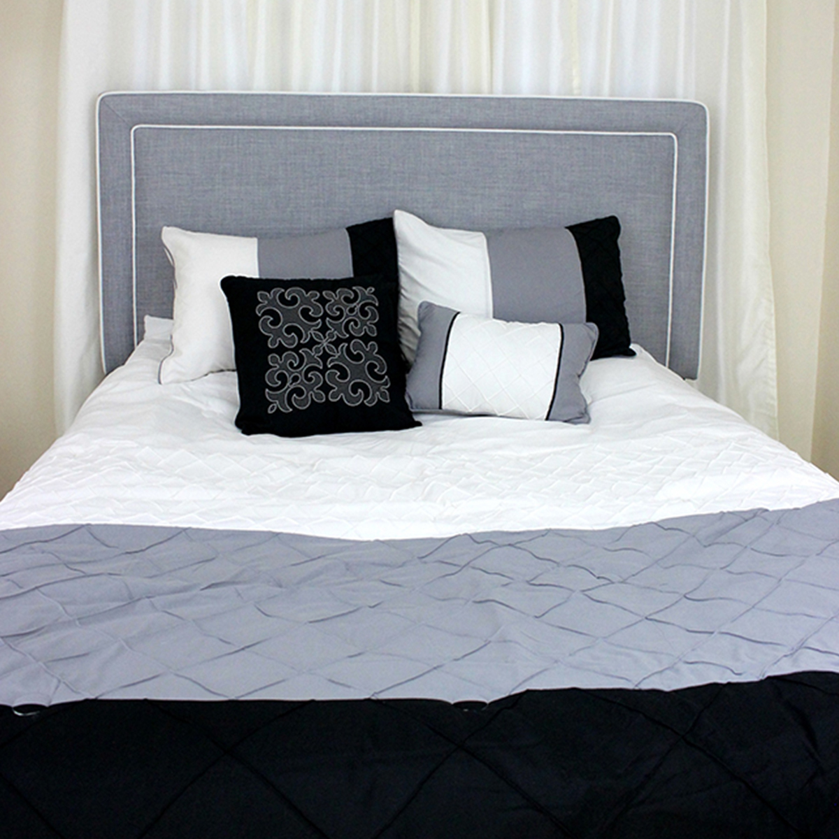 Headboard with border and contrasting stitching paired with an onyx 5-piece bedding comforter set fit for your guest room. photo