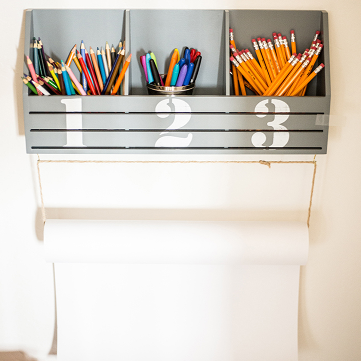 Slatted wall organizer to keep playtime in order. photo