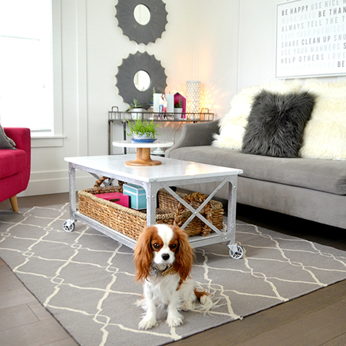 Create a modern farmhouse living room with a rustic country coffee table paired with marble cake stand. photo