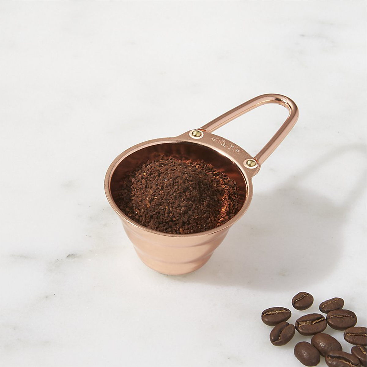 Small copper scoop for coffee grounds photo