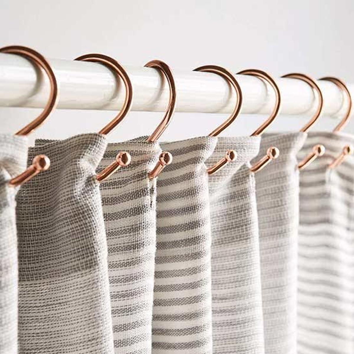 Copper shower hooks that will add a stylish touch to your bathroom. photo
