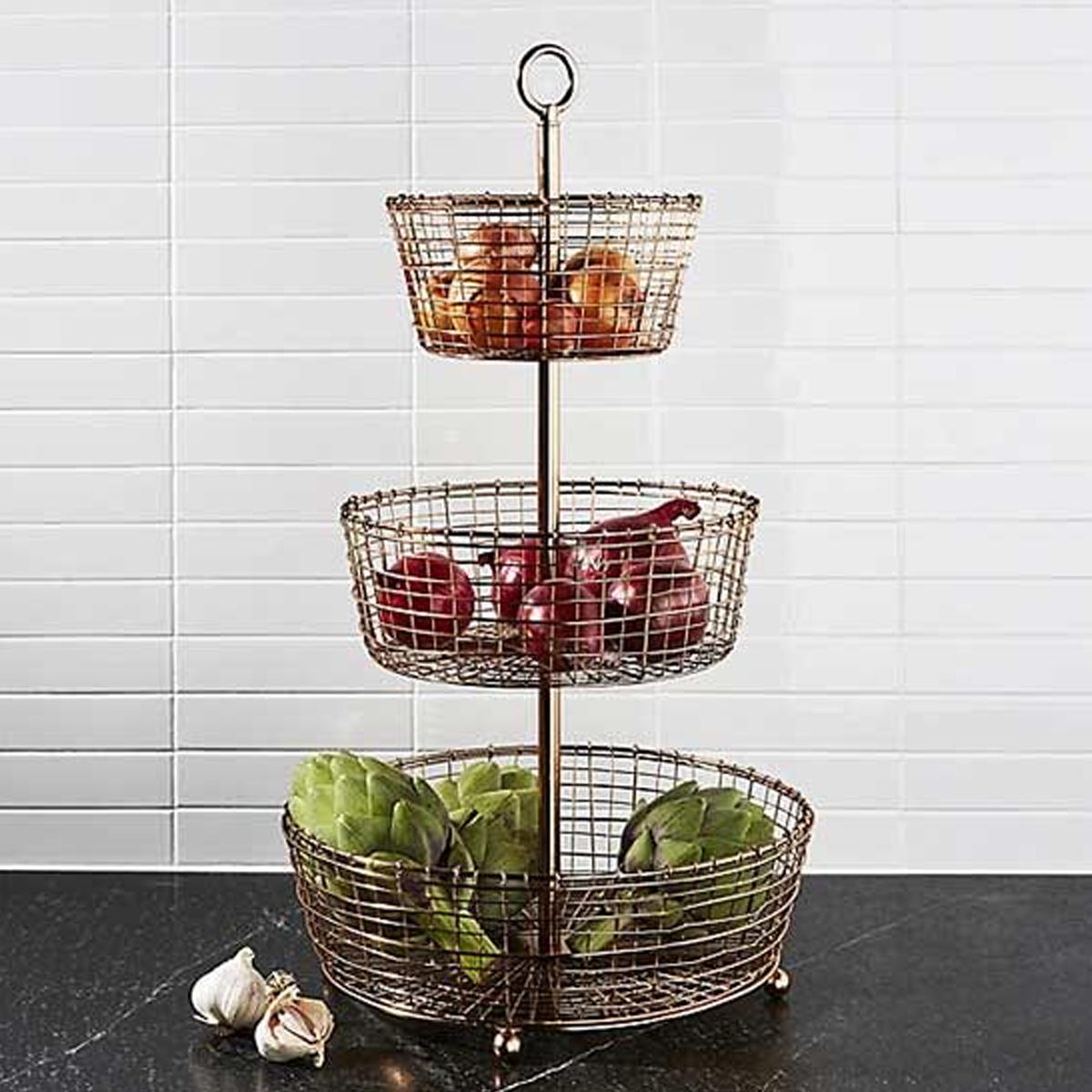 Sophisticated copper fruit holder with handcrafted iron-wire baskets. photo