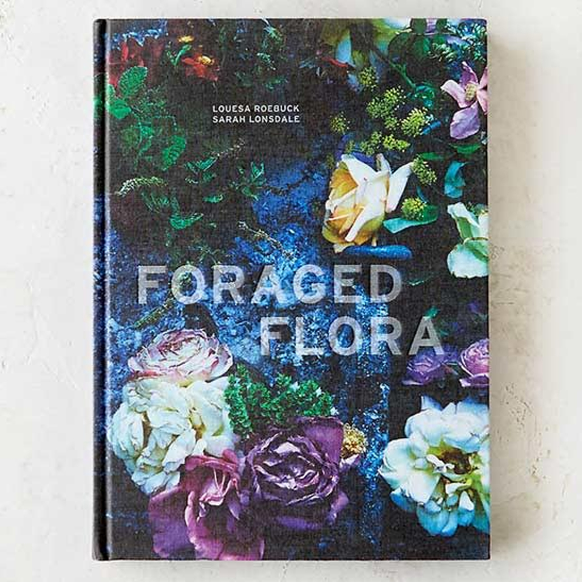 Foraged Flora coffee table book with beautiful photographs of large and small flower arrangements. photo