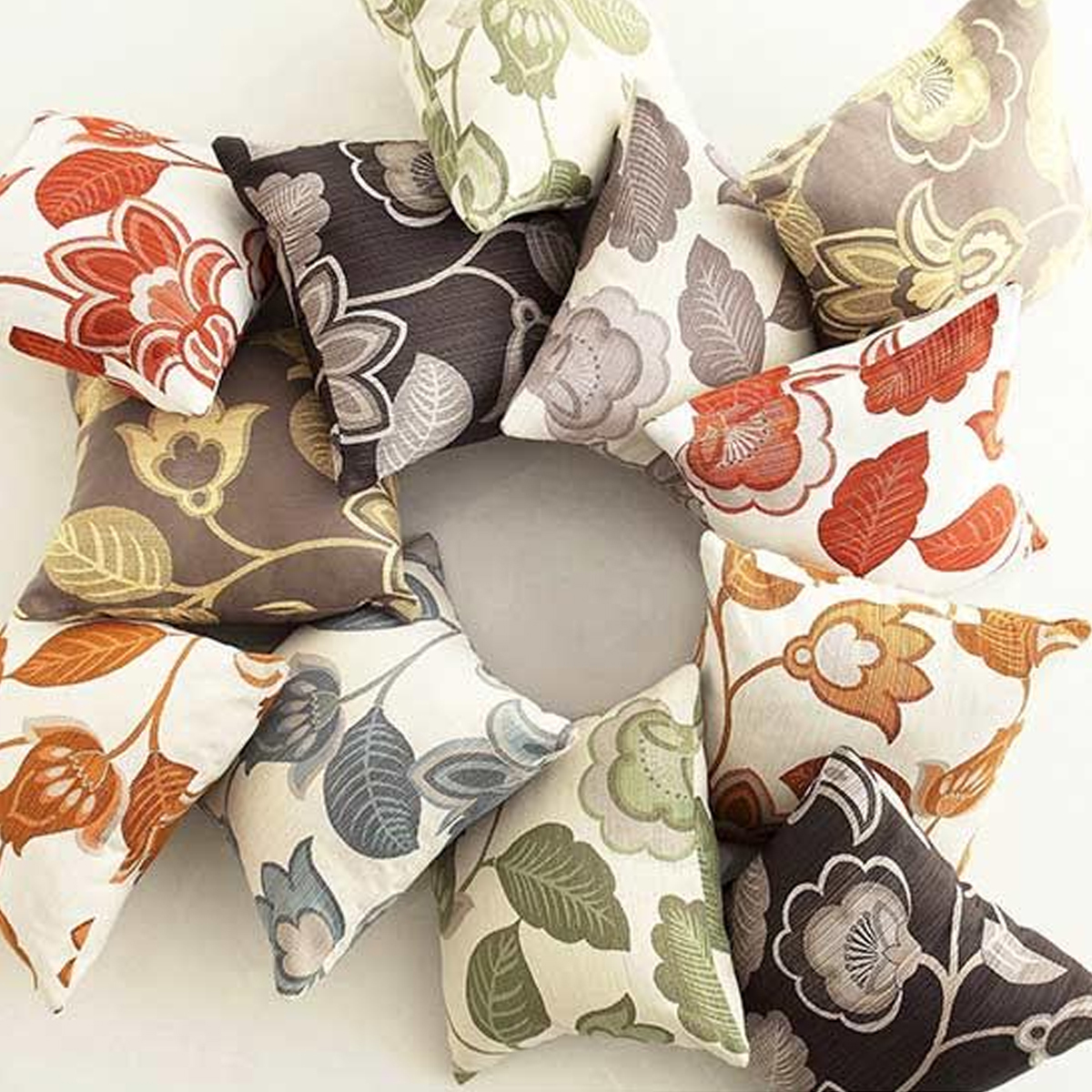 Floral-accented throw pillows that can add a little pop of color to any space. photo