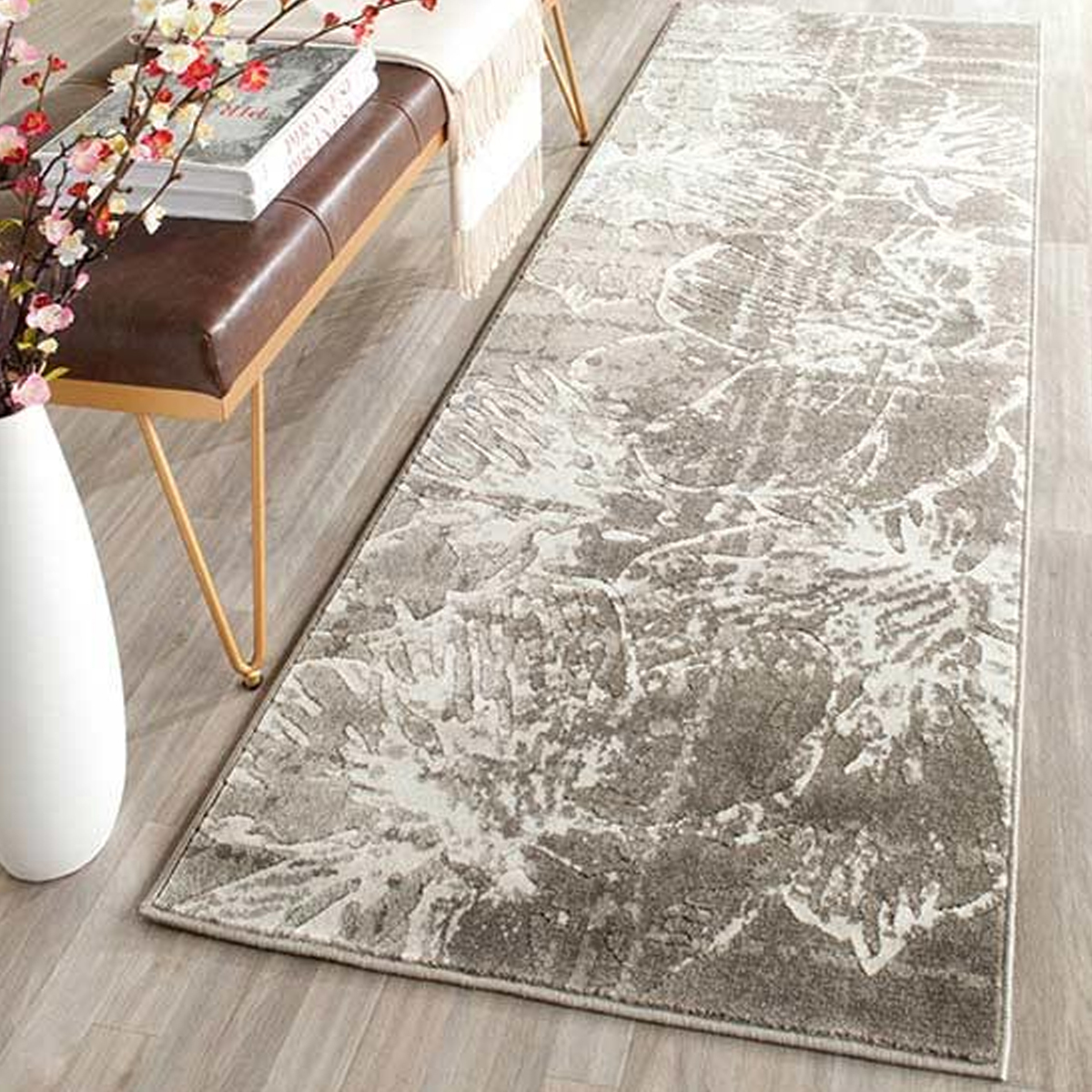 Trendy grey-and-white floral rug that is super soft and durable. photo