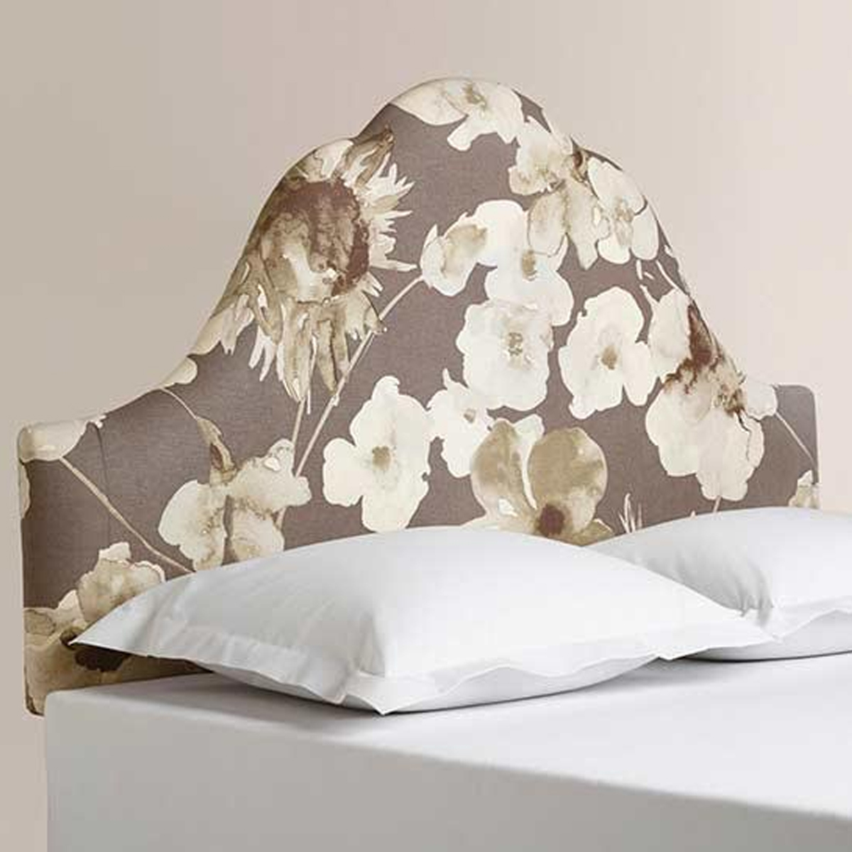 Upholstered headboard in a watercolor floral print is a statement piece we love. photo