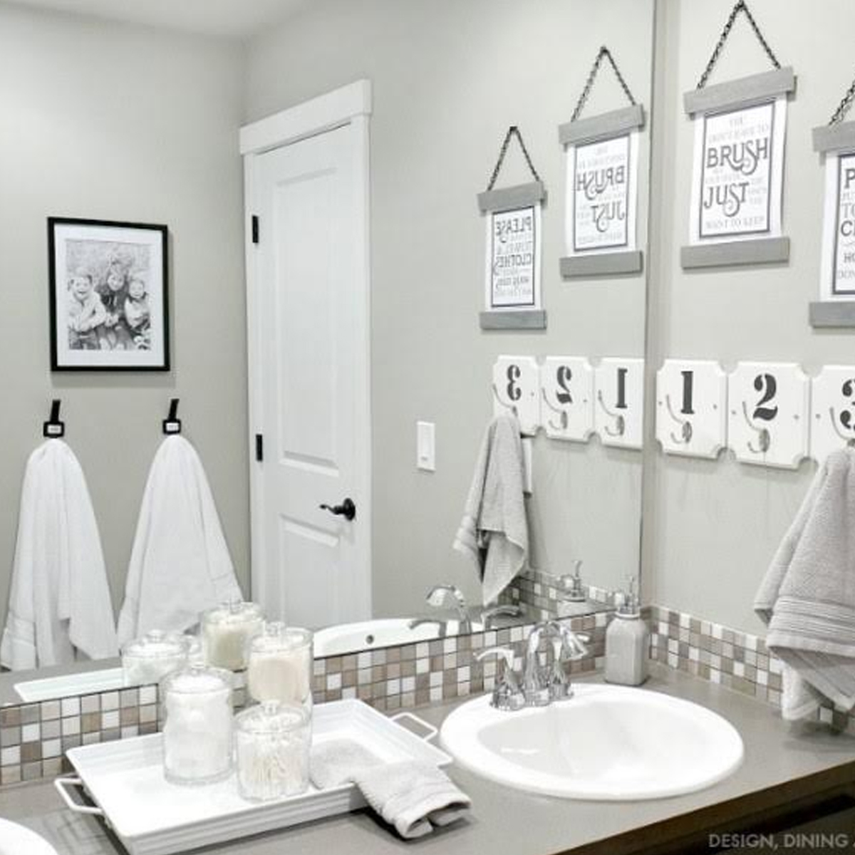 Bathroom with gray countertop and white towels photo
