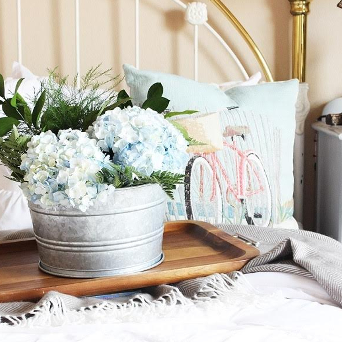 Wood tray with galvanized bucket and flowers photo