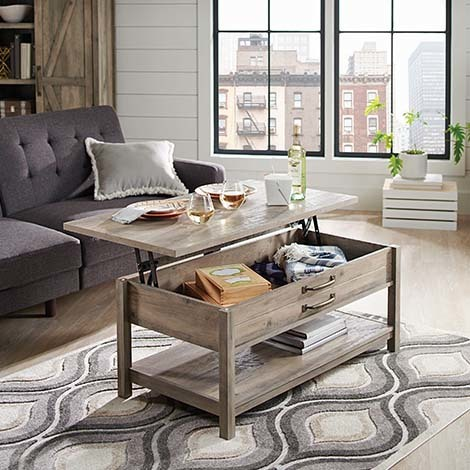 We love the Lift-Top Coffee Table because not only is it a stylish addition to your living room, but it's super functional as well. photo