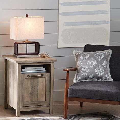 The rustic gray finish gives it a great aesthetic, and with storage on both the open shelf and behind the panel door, a functional piece of furniture has never looked so good. photo