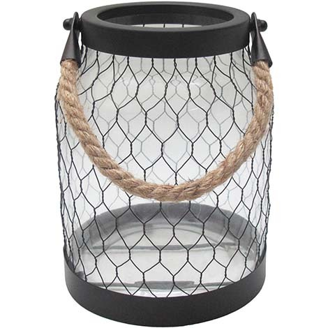 Glass lantern with a rope handle and wire detail. photo