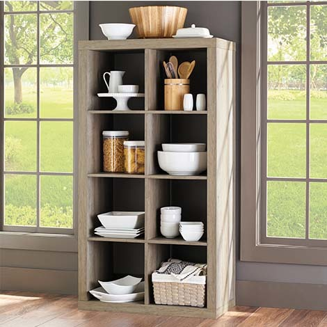 Plants, photos, books, and more all have a spot on the shelves of this 8-Cube Organizer. photo