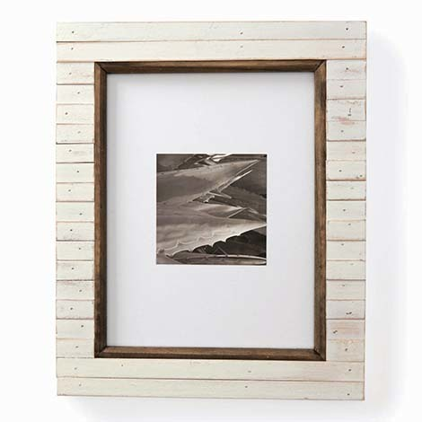 We love this charming frame, with its white-washed wood finish, that also comes with an easel for easy standing on a table, or the hanger in back, making it ready to be placed on the wall. photo