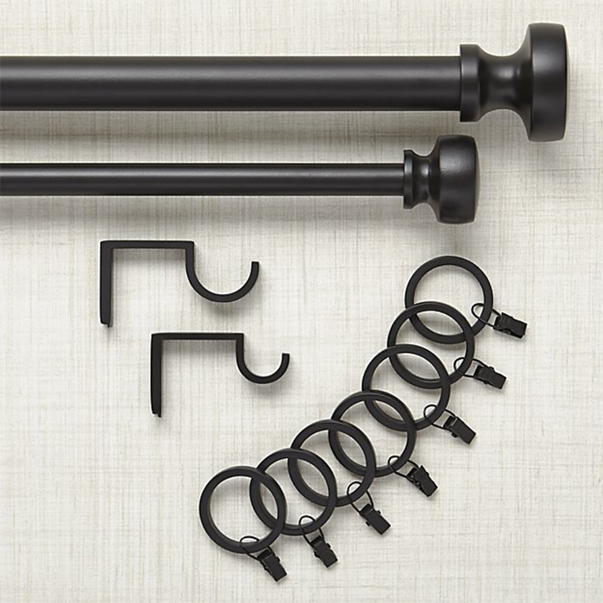 Telescopic rod, finials, brackets, and easy-glide rings, in a black finish photo